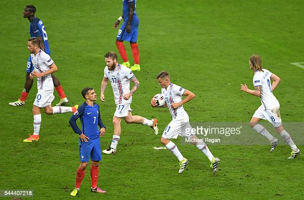 Birkir Bjarnason and Iceland players react after their team's second goal during the UEFA EURO 2016 quarter final match between France and Iceland at...