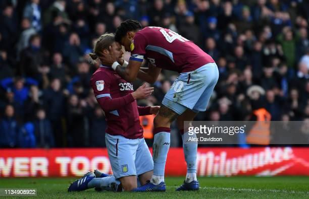 Birkir Bjarnason of Aston Villa and Tyrone Mings of Aston Villa celebrate keeping a goal out during the Sky Bet Championship match between Birmingham...