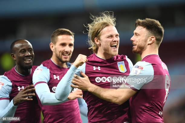 Birkir Bjarnason of Aston Villa celebrates after scoring his sides first goal with his team mates during the Sky Bet Championship match between Aston...