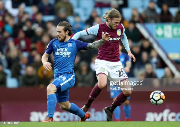 Birkir Bjarnason of Aston Villa evades Jack Marriott of Peterborough United during the The Emirates FA Cup Third Round match between Aston Villa and...