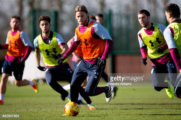 Birkir Bjarnason of Aston Villa in action during a Aston Villa training session at the club's training ground at Bodymoor Heath on February 17 2017...