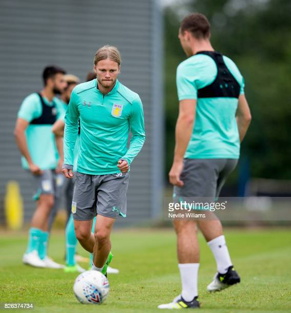 Birkir Bjarnason of Aston Villa in action during a Aston Villa training session at the club's training ground at Bodymoor Heath on August 04 2017 in...
