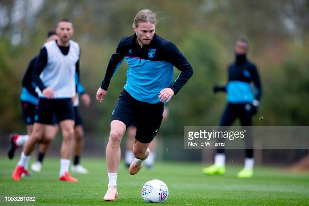 Birkir Bjarnason of Aston Villa in action during during a training session at the club's training ground at Bodymoor Heath on October 25 2018 in...