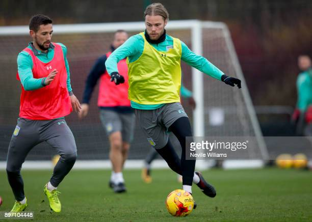 Birkir Bjarnason of Aston Villa in action with team mate Conor Hourihane during a training session at the club's training ground at Bodymoor Heath on...