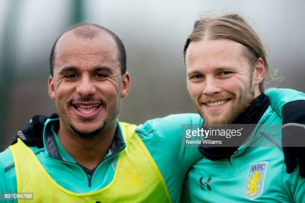 Birkir Bjarnason of Aston Villa in action with team mate Gabriel Agbonlahor during a training session at the club's training ground at Bodymoor Heath...