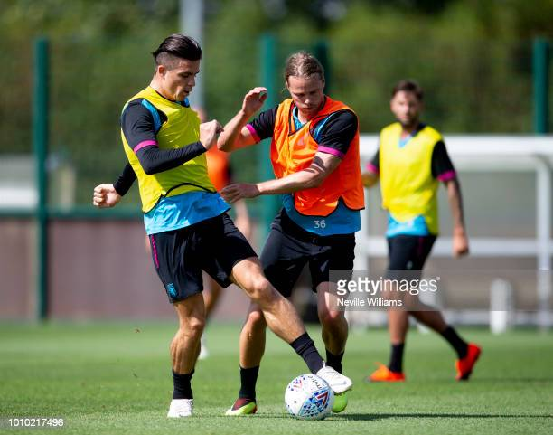 Birkir Bjarnason of Aston Villa in action with team mate Jack Grealish during a training session at the club's training ground at Bodymoor Heath on...