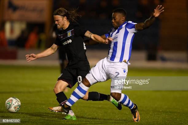 Birkir Bjarnason of Aston Villa is challenged by Ritchie De Laet of Colchester during the Carabao Cup First Round match between Colchester United and...
