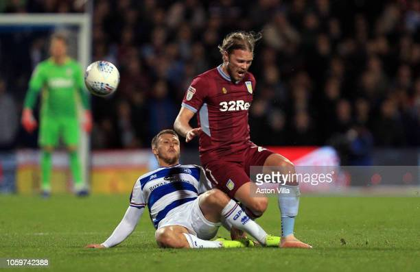 Birkir Bjarnason of Aston Villa is fouled by Luke Freeman of Queens Park Rangers during the Sky Bet Championship match between Queens Park Rangers...