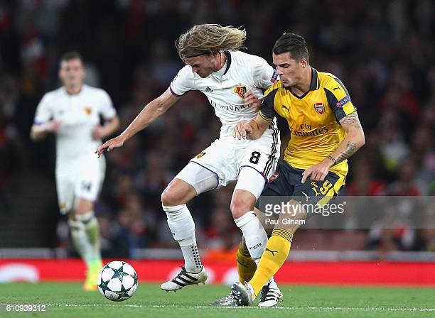 Birkir Bjarnason of Basel battles for the ball with har29 during the UEFA Champions League group A match between Arsenal FC and FC Basel 1893 at the...