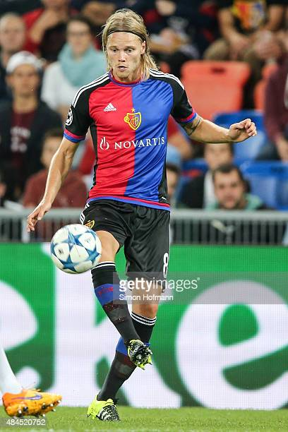 Birkir Bjarnason of Basel controls the ball during the UEFA Champions League qualifying round play off first leg match between FC Basel and Maccabi...