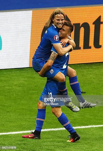 Birkir Bjarnason of Iceland and Arnor Ingvi Traustason of Iceland celebrate winning the UEFA EURO 2016 Group F match between Iceland and Austria at...
