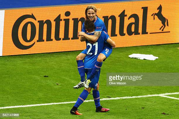 Birkir Bjarnason of Iceland and Arnor Ingvi Traustason of Iceland celebrate winning the UEFA EURO 2016 Group F match between Iceland and Austria at...