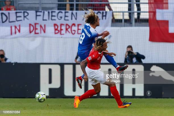 Birkir Bjarnason of Iceland and Kevin Mbabu of Switzerland battle for the ball during the UEFA Nations League A group two match between Switzerland...