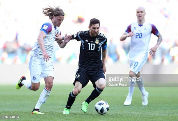 Birkir Bjarnason of Iceland and Lionel Messi of Argentina battle for the ball during the 2018 FIFA World Cup Russia group D match between Argentina...