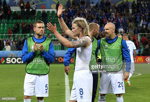 Birkir Bjarnason of Iceland and teammates thank their supporters following the UEFA EURO 2016 Group F match between Portugal and Iceland at Stade...