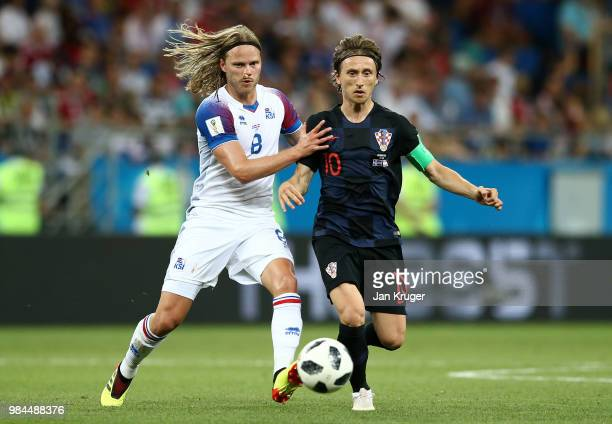 Birkir Bjarnason of Iceland battles for possession with Luka Modric of Croatia during the 2018 FIFA World Cup Russia group D match between Iceland...