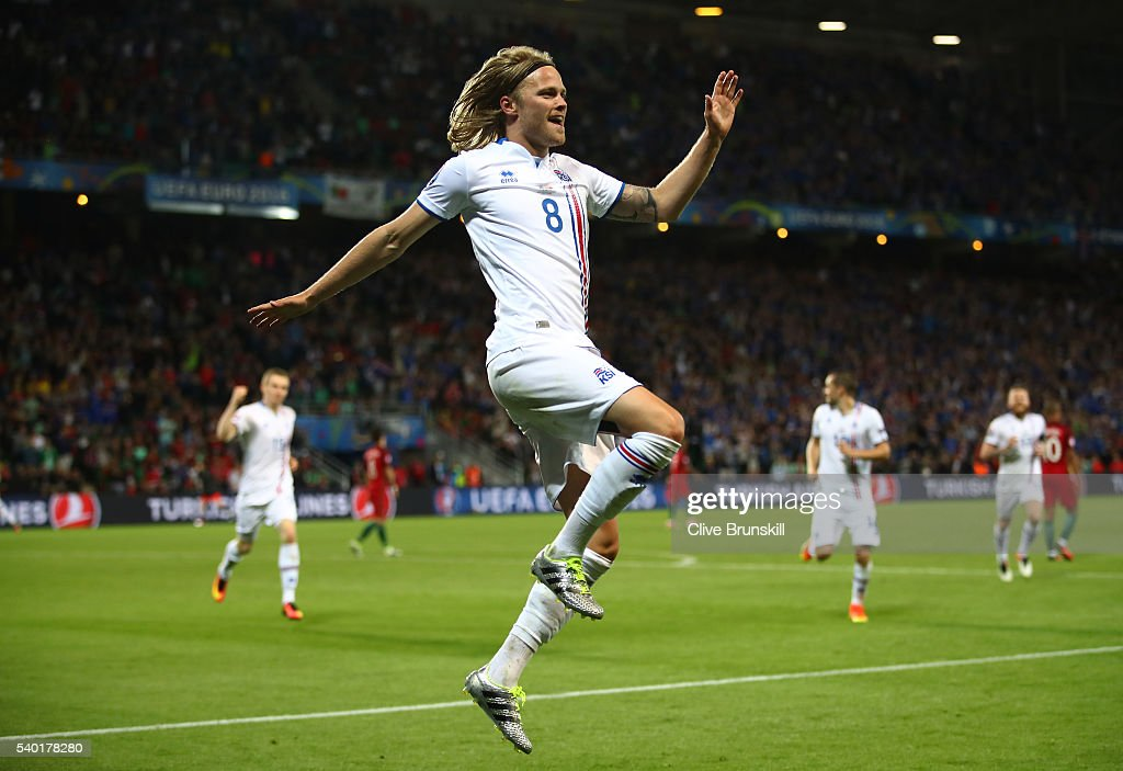 Birkir Bjarnason of Iceland celebrates scoring his team's first goal during the UEFA EURO 2016 Group F match between Portugal and Iceland at Stade Geoffroy-Guichard on June 14, 2016 in Saint-Etienne, France.