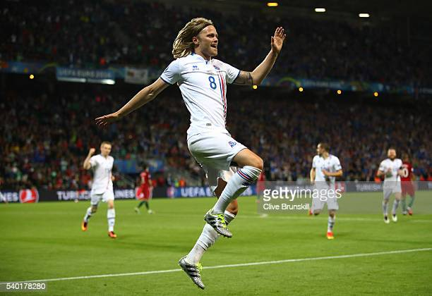 Birkir Bjarnason of Iceland celebrates scoring his team's first goal during the UEFA EURO 2016 Group F match between Portugal and Iceland at Stade...