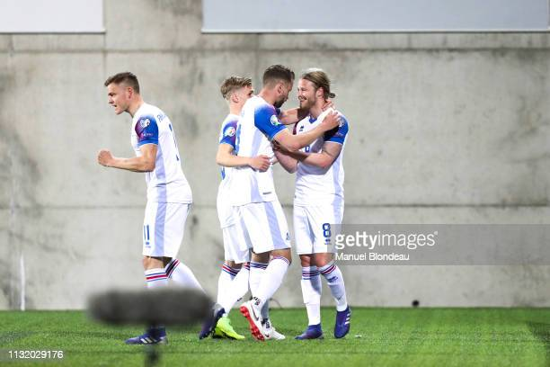 Birkir Bjarnason of Iceland celebrates with his teammates after scoring a goal during the Qualifying European Championship match between Andorra and...