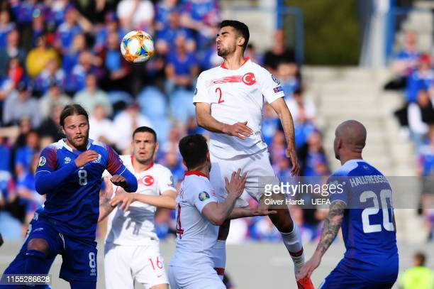 Birkir Bjarnason of Iceland challenges for the ball with Zeki Celik of Turkey during the UEFA Euro 2020 Qualifier match between Iceland and Turkey at...