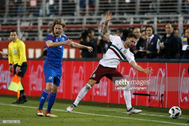 Birkir Bjarnason of Iceland challenges Miguel Layun of Mexico during their match at Levi's Stadium on March 23 2018 in Santa Clara California