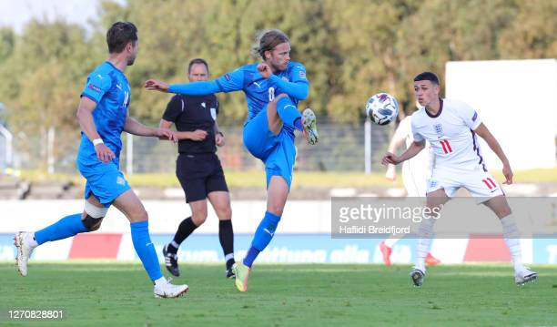 Birkir Bjarnason of Iceland controls the ball while under pressure from Phil Foden of England during the UEFA Nations League group stage match...