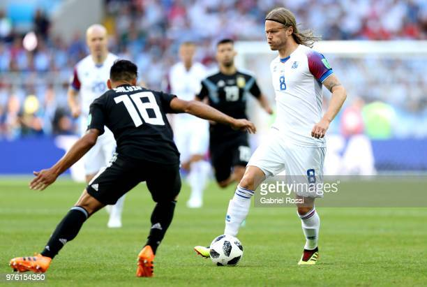 Birkir Bjarnason of Iceland is challenged by Eduardo Salvio of Argentina during the 2018 FIFA World Cup Russia group D match between Argentina and...