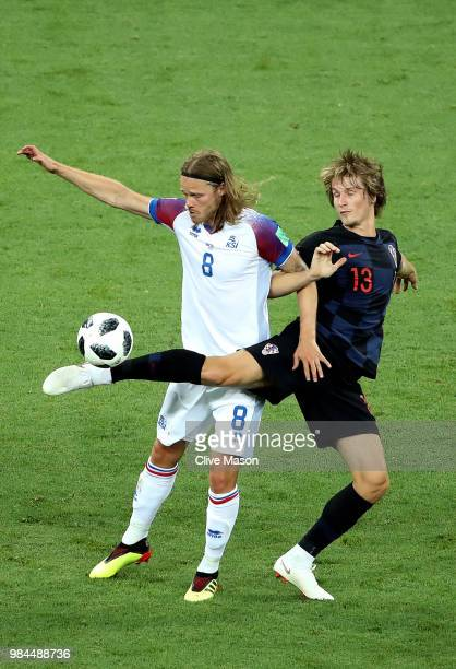 Birkir Bjarnason of Iceland is challenged by Tin Jedvaj of Croatia during the 2018 FIFA World Cup Russia group D match between Iceland and Croatia at...