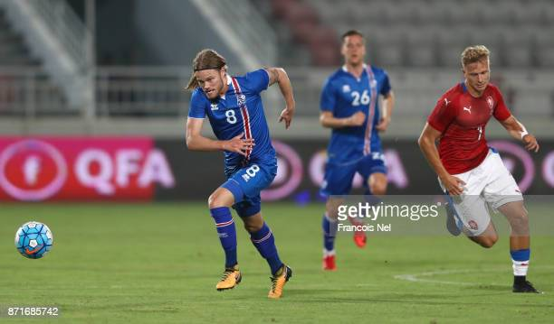 Birkir Bjarnason of Iceland is chased by Antonin Barak of the Czech Republic during the international friendly match between Iceland and Czech...