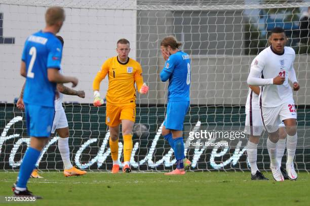 Birkir Bjarnason of Iceland reacts after missing a penalty kick as Jordan Pickford of England celebrates during the UEFA Nations League group stage...