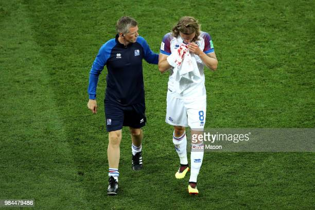 Birkir Bjarnason of Iceland receives medical treatment during the 2018 FIFA World Cup Russia group D match between Iceland and Croatia at Rostov...