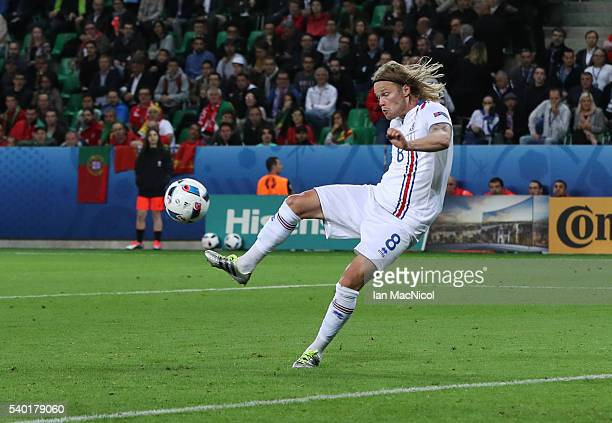 Birkir Bjarnason of Iceland scores during the UEFA EURO 2016 Group F match between Portugal and Iceland at Stade GeoffroyGuichard on June 14 2016 in...