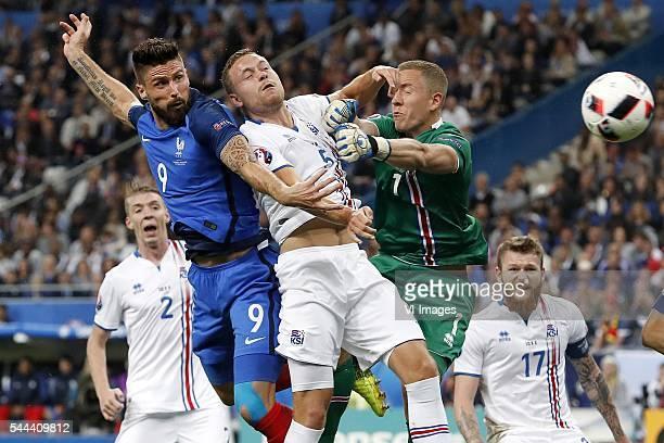 Birkir Mar Saevarsson of Iceland Olivier Giroud of France Sverrir Ingason of Iceland goalkeeper Hannes Por Halldorsson of Iceland Aron Einar...