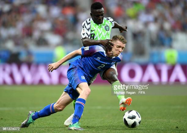 Birkir Saevarsson of Iceland is pulled back by Oghenekaro Etebo of Nigeria during the 2018 FIFA World Cup Russia group D match between Nigeria and...