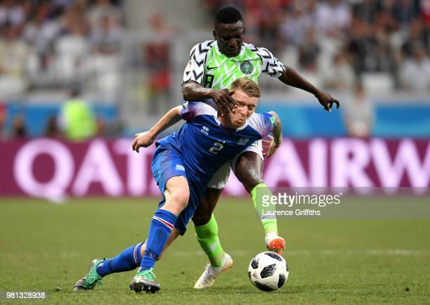 Birkir Saevarsson of Iceland is tackled by Oghenekaro Etebo of Nigeria during the 2018 FIFA World Cup Russia group D match between Nigeria and...