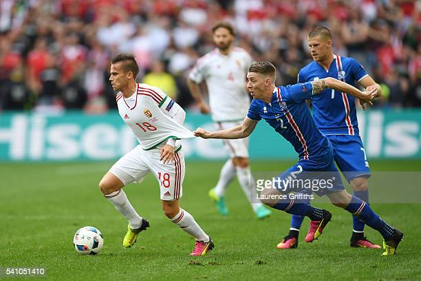 Birkir Saevarsson of Iceland pulls the shirt of Zoltan Stieber of Hungary during the UEFA EURO 2016 Group F match between Iceland and Hungary at...