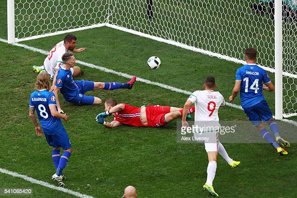 Birkir Saevarsson of Iceland scores an own goal after pressure from Daniel Bode of Hungary to make the score 11 during the UEFA EURO 2016 Group F...