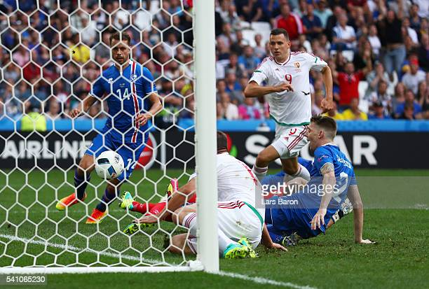 Birkir Saevarsson of Iceland scores an own goal to make the score 11 during the UEFA EURO 2016 Group F match between Iceland and Hungary at Stade...