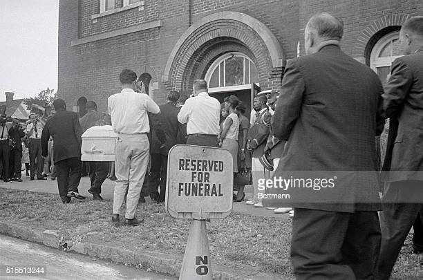 A white casket containing the body of 14yearold Carol Robertson one of four young Negroes killed here early morning when a dynamite bomb exploded in...