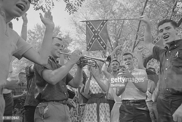Confederate flagwaving students join in singing Dixie to accompaniment of trumpet as they demonstrate outside West End High School here September 10...