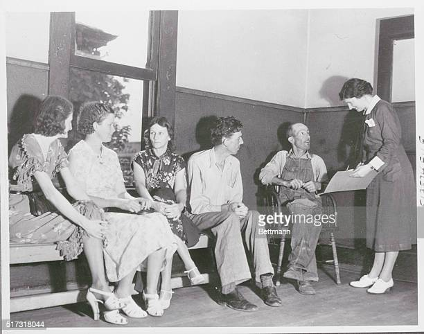Birmingham, Alabama: WPA nurse interviews a patient in a tuberculosis clinic while four other patients await their turn.