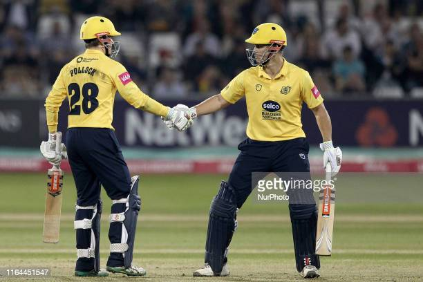 Birmingham Bears' Ed Pollock celebrates his fifty with Sam Hain during the Vitality T20 Blast match between Durham County Cricket Club and Birmingham...