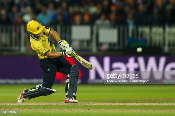 Birmingham Bears' Sam Hain hits the ball over the boundary for six to reach his half century during the NatWest T20 Blast Final match between...