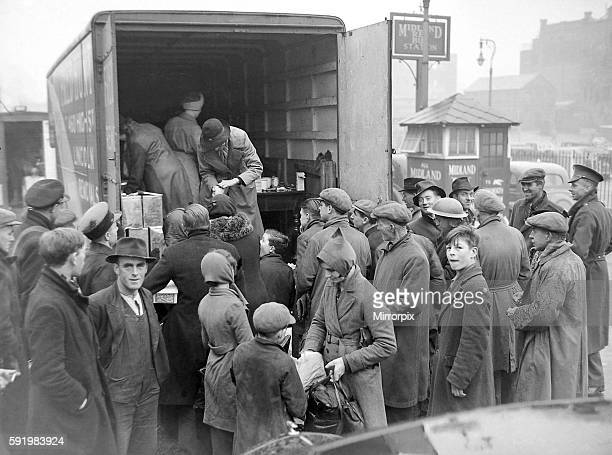 Birmingham Blitz 1940 People buying rationed goods from the back of van parked in the Midland Red bus station at Pool Meadow Coventry 18th November...