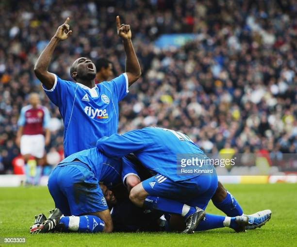 Birmingham City celebrate the late equaliser from Stern John during the FA Barclaycard Premiership match between Aston Villa and Birmingham City at...