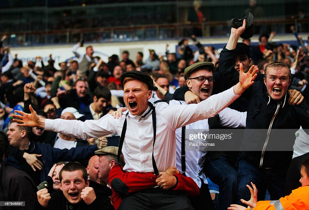 Birmingham City fans celebrate as they avoid relegation after the Sky Bet Championship match between Bolton Wanderers and Birmingham City at Reebok Stadium on May 3, 2014 in Bolton, England.