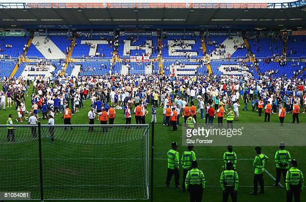 Birmingham City fans invade the pitch after their team was relegated during the Barclays Premier League match between Birmingham City and Blackburn...