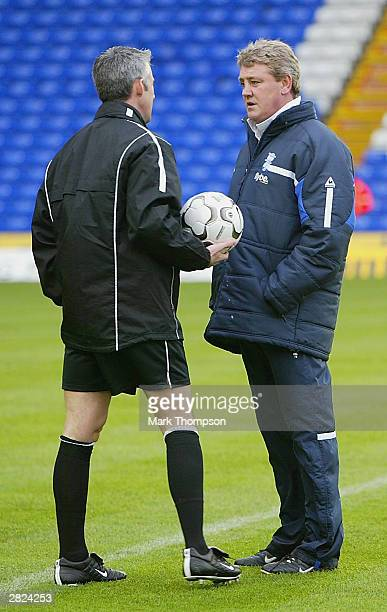 Birmingham City Manager Steve Bruce and the referee Mr C Foy inspect a waterlogged pitch before the FA Barclaycard Premiership match between...