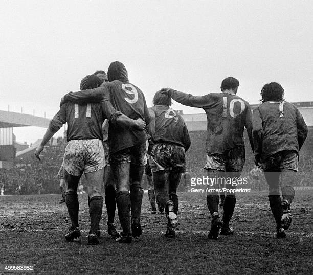 Birmingham City players congratulate Bob Latchford after his goal against Norwich City during their First Divison match on a wet and muddy day at St...