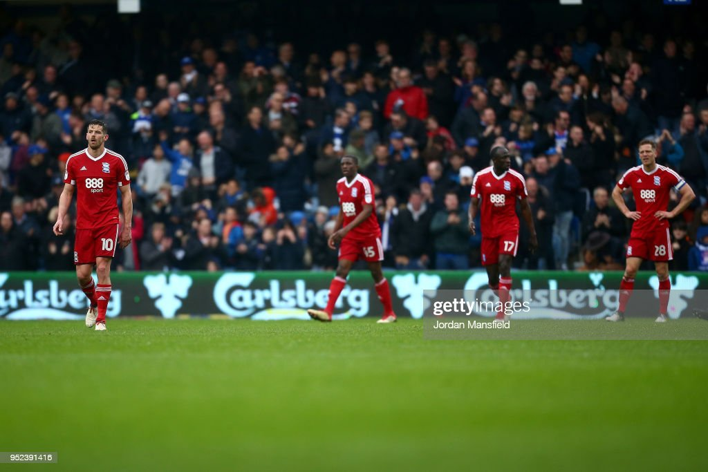 Birmingham City players look dejected after conceeding QPR's second goal during the Sky Bet Championship match between Queens Park Rangers and Birmingham City at Loftus Road on April 28, 2018 in London, England.